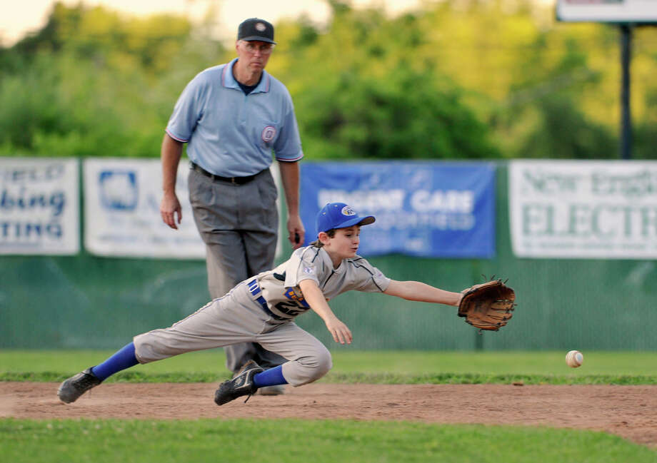 Brookfield shortstop Mike Quinn dives for the ball during Brookfield's 10-year-old Cal Ripken League District Championship game against Bethel at Grays Bridge Field in Brookfield on Wednesday, June 27, 2012. Bethel won, 11 to 8. Photo: Jason Rearick / The News-Times