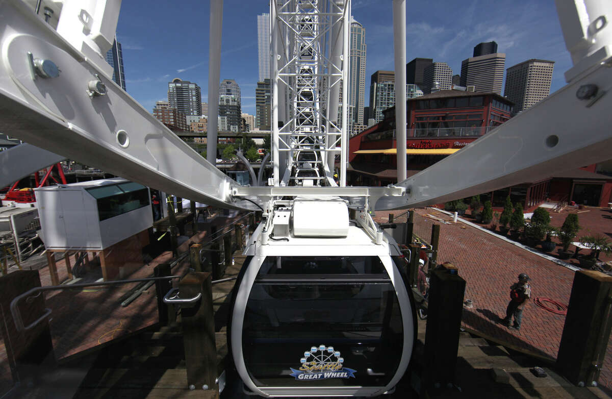 The new Seattle Great Wheel takes a few turns on Wednesday, June 27, 2012.