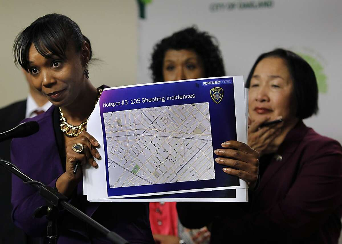 Reygan Harmon, senior policy advisor for public safety, displays a neighborhood crime map while Oakland Mayor Jean Quan (right) admitted erroneous statistical data was used to implement her controversial 100 Blocks anti-crime plan but defended the program at a City Hall news conference in Oakland, Calif. on Wednesday, June 27, 2012.