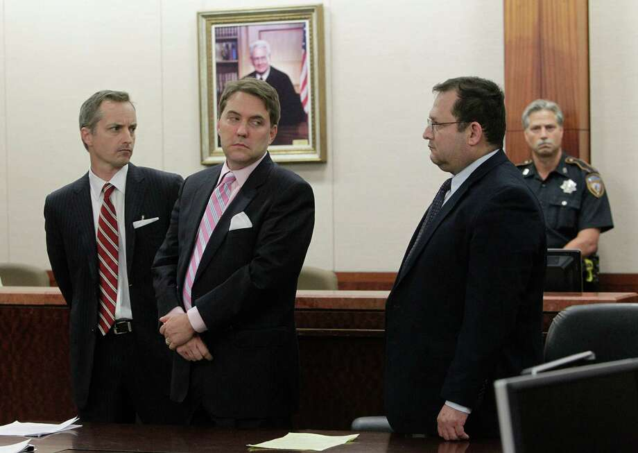 Attorneys Bill Stradley and Neal Davis turn to Raul Rodriguez as he learns his 40-year sentence Wednesday in a 2010 fatal shooting. Photo: Mayra Beltran / © 2012 Houston Chronicle