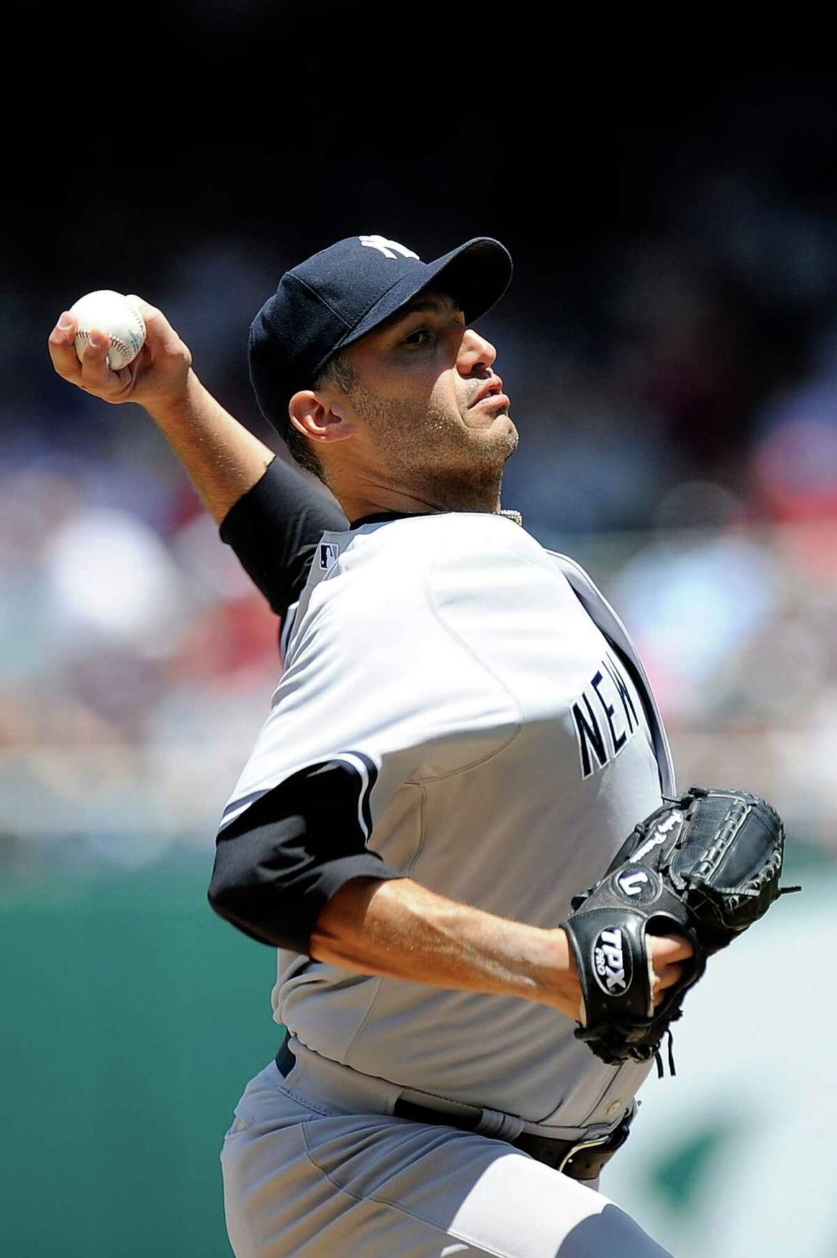 WASHINGTON, DC - JUNE 16: Andy Pettitte #46 of the New York Yankees throws a pitch against the Washington Nationals at Nationals Park on June 16, 2012 in Washington, DC. (Photo by Patrick McDermott/Getty Images)