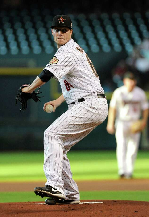Houston Astros' Lucas Harrell delivers a pitch against the San Diego Padres in the first inning of a baseball game Wednesday, June 27, 2012, in Houston. Photo: AP