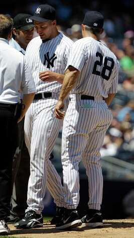 New York Yankees' Andy Pettitte leaves the game with an injury during the fifth inning of a baseball game against the Cleveland Indians Wednesday, June 27, 2012, in New York. (AP Photo/Frank Franklin II) Photo: Frank Franklin II