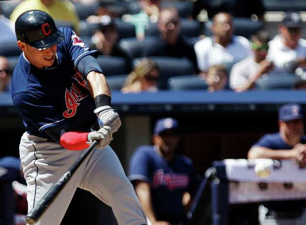 Cleveland Indians' Asdrubal Cabrera htis an RBI single during the fifth inning of a baseball game against the New York Yankees Wednesday, June 27, 2012, in New York. (AP Photo/Frank Franklin II) Photo: Frank Franklin II