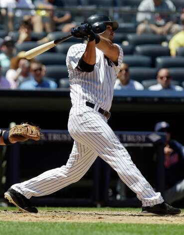 New York Yankees' Eric Chavez hits a two-run double during the fourth inning of a baseball game against the Cleveland Indians, Wednesday, June 27, 2012, in New York. (AP Photo/Frank Franklin II) Photo: Frank Franklin II