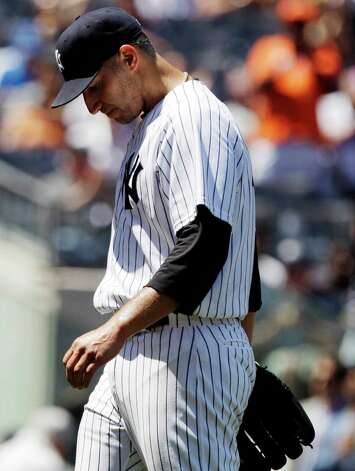 New York Yankees' Andy Pettitte leaves the game during the fifth inning of a baseball game against the Cleveland Indians Wednesday, June 27, 2012, in New York. (AP Photo/Frank Franklin II) Photo: Frank Franklin II