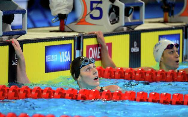 Missy Franklin, left, and Katie Hoff check the clock after heat in the women's 200-meter freestyle preliminaries at the U.S. Olympic swimming trials, Wednesday, June 27, 2012, in Omaha, Neb. (AP Photo/Mark J. Terrill) Photo: Associated Press