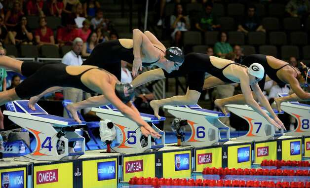 Jasmine Tosky, from left, Allison Schmitt and Morgan Scroggy dive at the start of their heat in the women's 200-meter freestyle preliminaries at the U.S. Olympic swimming trials, Wednesday, June 27, 2012, in Omaha, Neb. (AP Photo/Mark J. Terrill) Photo: Associated Press