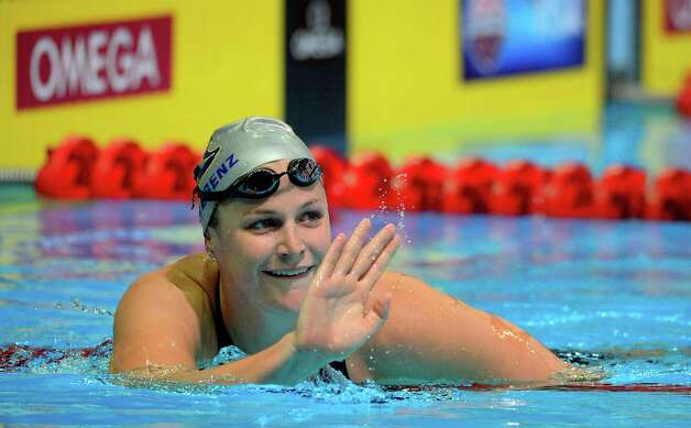 Caitlin Leverenz waves after swimming in the women's 200-meter individual medley preliminaries at the U.S. Olympic swimming trials, Wednesday, June 27, 2012, in Omaha, Neb. (AP Photo/Mark J. Terrill) Photo: Associated Press