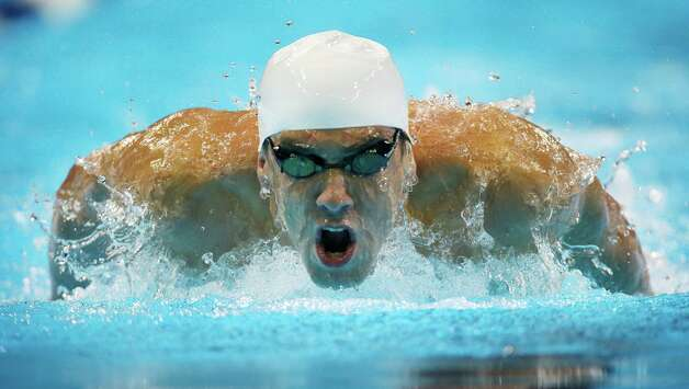 Michael Phelps swims in the men's 200-meter butterfly preliminaries at the U.S. Olympic swimming trials on Wednesday, June 27, 2012, in Omaha, Neb. (AP Photo/Mark Humphrey) Photo: Associated Press