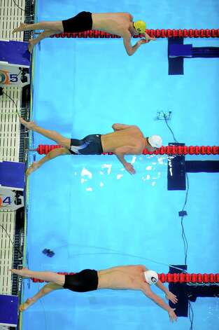 Dan Madwed, from top, Michael Phelps and Mark Dylla start in the men's 200-meter butterfly preliminaries at the U.S. Olympic swimming trials, Wednesday, June 27, 2012, in Omaha, Neb. (AP Photo/Mark J. Terrill) Photo: Associated Press