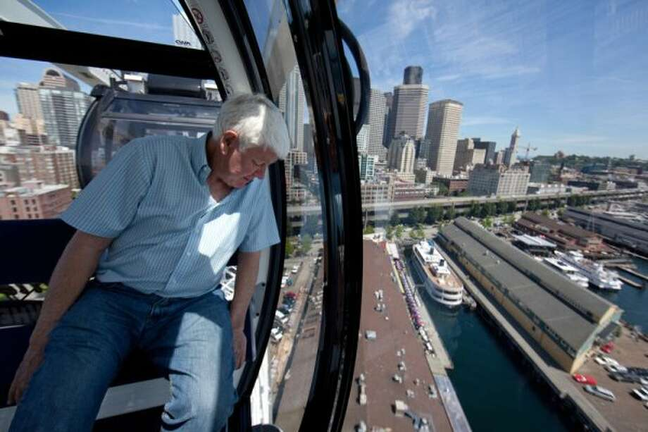 Hal Griffith, owner of Seattle's Pier 57, rides on the new Seattle Great Wheel on June 27, 2012. The observation wheel on the Seattle waterfront takes riders more than 175 feet over Puget Sound, offering a  view of the Seattle waterfront. (JOSHUA TRUJILLO / SEATTLEPI.COM)