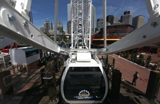 The new Seattle Great Wheel takes a few turns on June 27, 2012. (JOSHUA TRUJILLO / SEATTLEPI.COM)