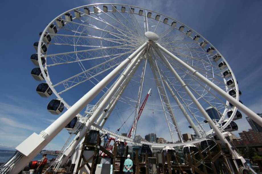 The new Seattle Great Wheel is shown on Wednesday, June 27, 2012. The observation wheel on the Seattle waterfront takes riders more than 175 feet over Puget Sound, offering a new view of the Seattle waterfront. (JOSHUA TRUJILLO / SEATTLEPI.COM)