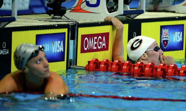 Shannon Vreeland, right, reacts after swimming in a women's 200-meter freestyle semifinal at the U.S. Olympic swimming trials, Wednesday, June 27, 2012, in Omaha, Neb. At left is Dana Vollmer. (AP Photo/Mark J. Terrill) Photo: Associated Press