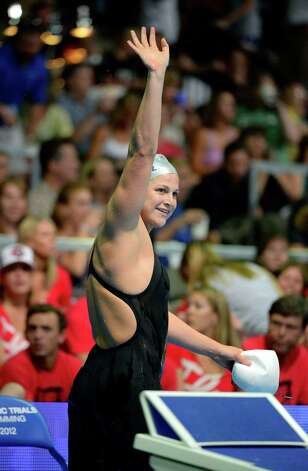 Caitlin Leverenz waves after swimming in a women's 200-meter individual medley semifinal at the U.S. Olympic swimming trials, Wednesday, June 27, 2012, in Omaha, Neb. (AP Photo/Mark J. Terrill) Photo: Associated Press