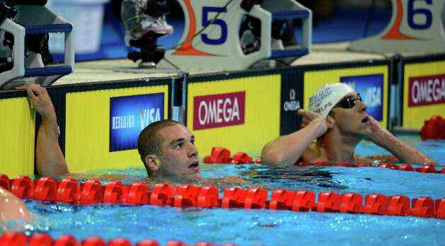Bobby Bollier, left, and Michael Phelps look at the clock after competing in a men's 200-meter butterfly semifinal at the U.S. Olympic swimming trials, Wednesday, June 27, 2012, in Omaha, Neb. (AP Photo/Mark J. Terrill) Photo: Associated Press