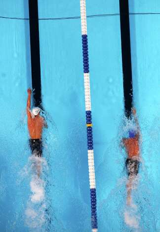 Michael Phelps, left, and Ryan Lochte compete in the men's 200-meter freestyle final at the U.S. Olympic swimming trials, Wednesday, June 27, 2012, in Omaha, Neb. Michael Phelps won the final. (AP Photo/Nati Harnik) Photo: Associated Press