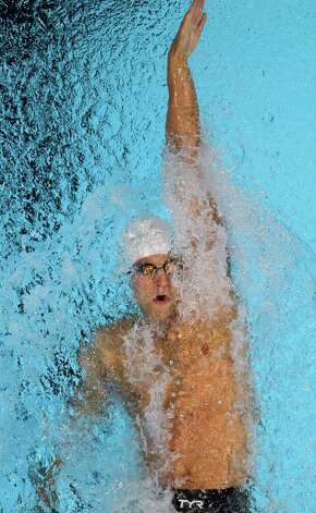 Matt Grevers swims to victory in the men's 100-meter backstroke final at the U.S. Olympic swimming trials, Wednesday, June 27, 2012, in Omaha, Neb. (AP Photo/Nati Harnik) Photo: Associated Press