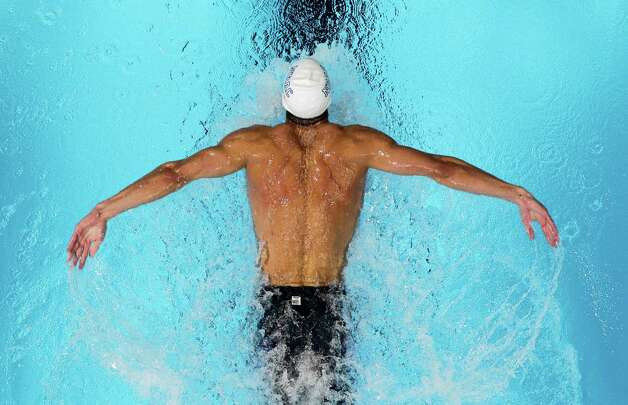 Michael Phelps swims in a men's 200-meter butterfly semifinal at the U.S. Olympic swimming trials, Wednesday, June 27, 2012, in Omaha, Neb. (AP Photo/Nati Harnik) Photo: Associated Press
