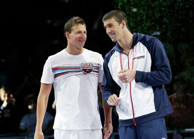 Ryan Lochte, left, and Michael Phelps talk during the medal ceremony after Phelps won the men's 200-meter freestyle final at the U.S. Olympic swimming trials on Wednesday, June 27, 2012, in Omaha, Neb. (AP Photo/Mark Humphrey) Photo: Associated Press