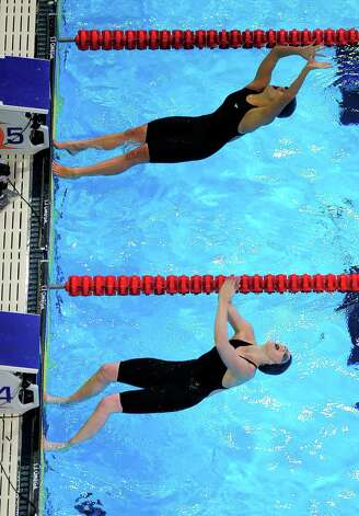 Rachel Bootsma, top, and Missy Franklin swim in the women's 100-meter backstroke final at the U.S. Olympic swimming trials, Wednesday, June 27, 2012, in Omaha, Neb. (AP Photo/Mark J. Terrill) Photo: Associated Press