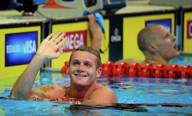 Tyler Clary waves after swimming in a men's 200-meter butterfly semifinal at the U.S. Olympic swimming trials, Wednesday, June 27, 2012, in Omaha, Neb. (AP Photo/Mark J. Terrill) Photo: Associated Press