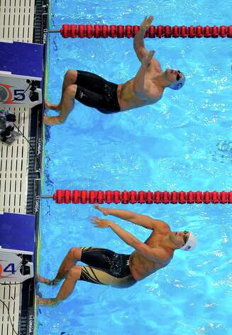 David�Plummer, top, and Matt Grevers, swim in the men's 100-meter backstroke final at the U.S. Olympic swimming trials, Wednesday, June 27, 2012, in Omaha, Neb. (AP Photo/Mark J. Terrill) Photo: Associated Press