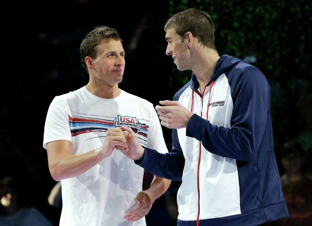 Ryan Lochte, left, shakes hands with Michael Phelps during the medal ceremony after Phelps won the men's 200-meter freestyle final at the U.S. Olympic swimming trials on Wednesday, June 27, 2012, in Omaha, Neb. (AP Photo/Mark Humphrey) Photo: Associated Press
