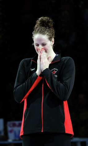 Missy Franklin poses during the medal ceremony after winning the women's 100-meter backstroke final at the U.S. Olympic swimming trials on Wednesday, June 27, 2012, in Omaha, Neb. (AP Photo/Mark Humphrey) Photo: Associated Press