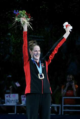 Missy Franklin celebrates during the medal ceremony after winning the women's 100-meter backstroke final at the U.S. Olympic swimming trials on Wednesday, June 27, 2012, in Omaha, Neb. (AP Photo/Mark Humphrey) Photo: Associated Press