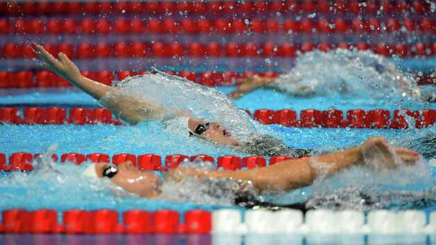Caitlin Leverenz compete in the women's 200-meter individual medley semifinal at the U.S. Olympic swimming trials, Wednesday, June 27, 2012, in Omaha, Neb. (AP Photo/Mark J. Terrill) Photo: Associated Press