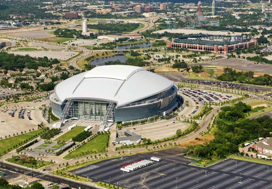In this aerial photograph taken on Tuesday, Aug. 18, 2009, the Dallas Cowboys new football stadium Cowboys Stadium is shown in Arlington, Texas. (AP Photo/Brandon Wade) Photo: Brandon Wade / FR168019 AP