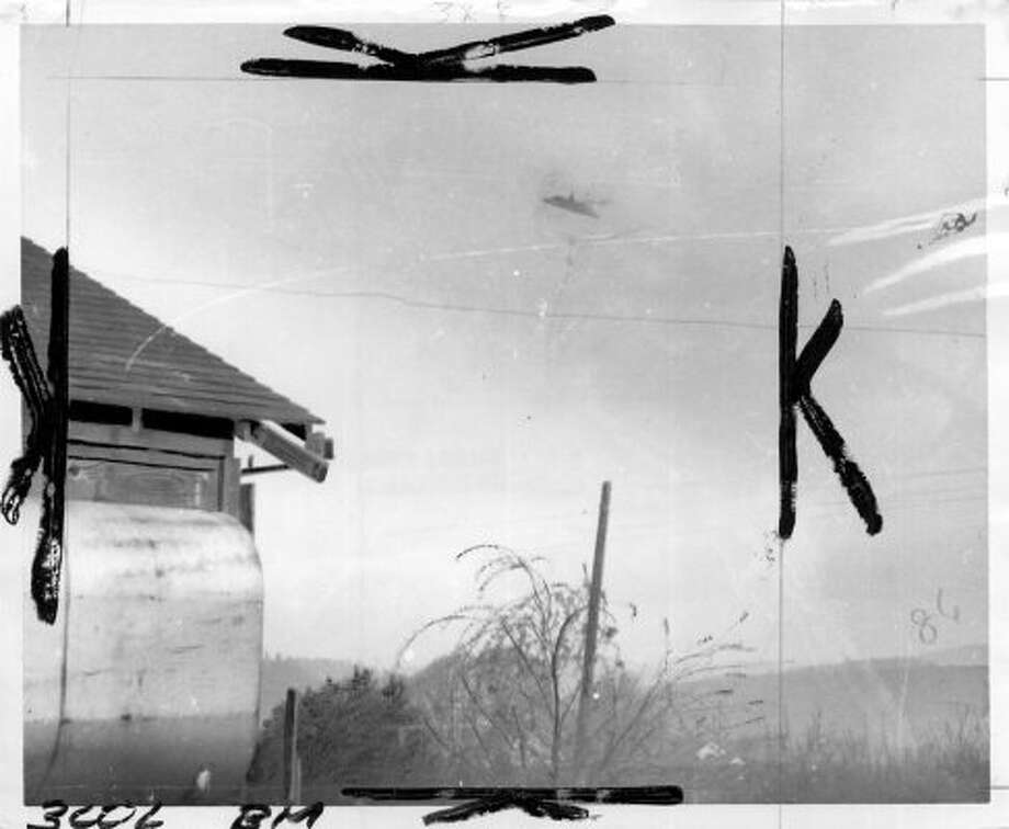 The P-I archive copy of Paul Trents 1950 UFO photo from McMinnville, Ore. Marks were made by a photo editor at the time. (seattlepi.com file)