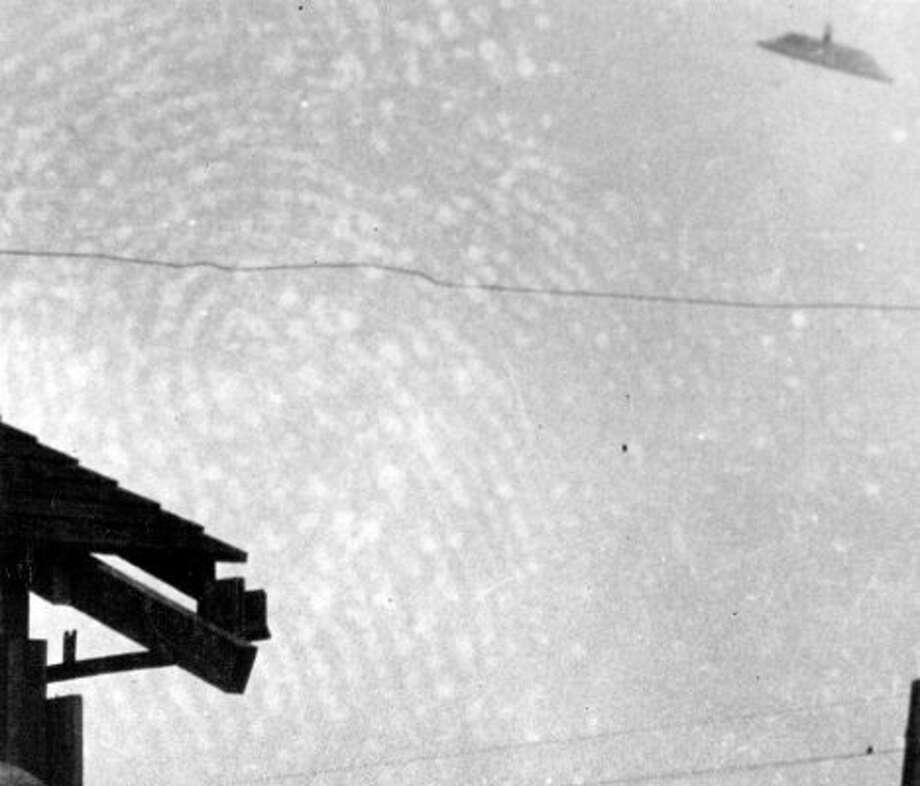Another P-I archive copy of Paul Trent's 1950 UFO photo. (A photo editor's print is also included.) (seattlepi.com file)