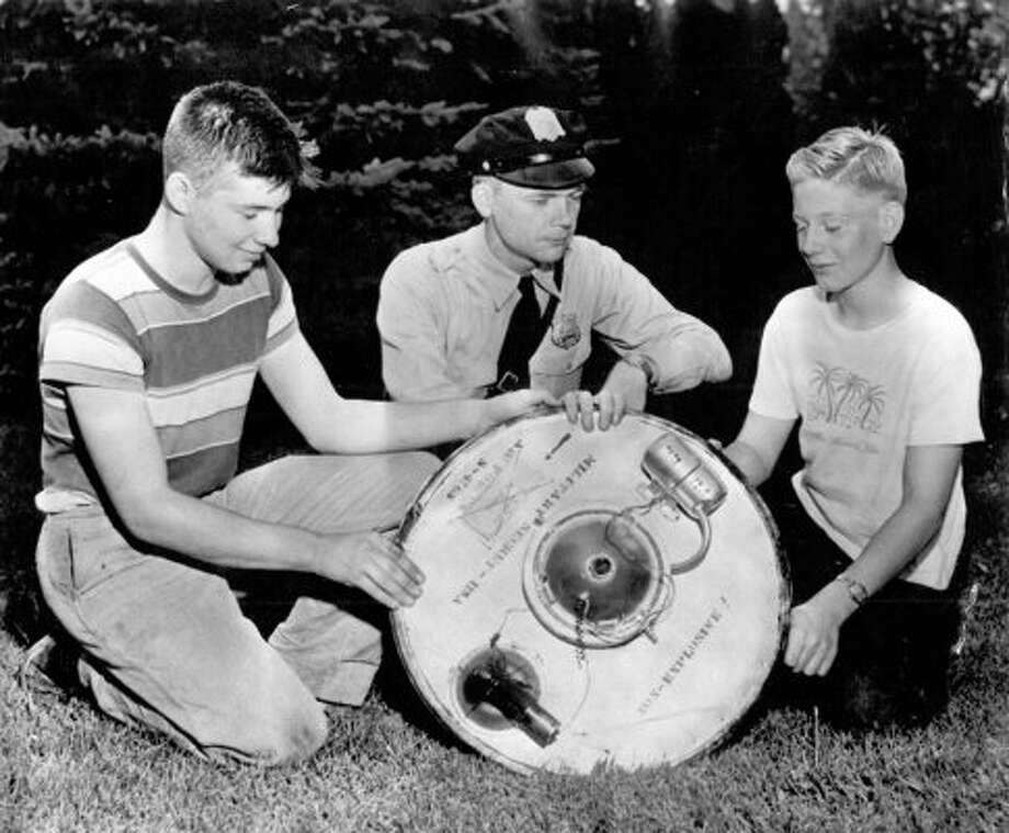 John Feick, 15, and Paul Fisher, 14, at right, received attention from Reading, Penn., police after building a flying saucer to fool people in Sept. 1950. (seattlepi.com file)