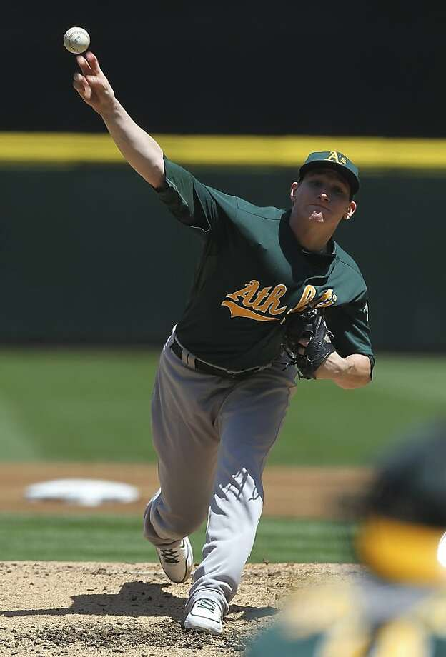 SEATTLE, WA - JUNE 27:  Starting pitcher Jarrod Parker #11 of the Oakland Athletics pitches against the Seattle Mariners at Safeco Field on June 27, 2012 in Seattle, Washington.(Photo by Otto Greule Jr/Getty Images) Photo: Otto Greule Jr, Getty Images