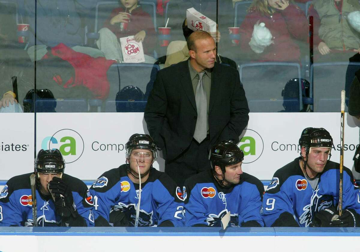 BRIDGEPORT, CT - NOVEMBER 13: Head Coach Greg Cronin of the Bridgeport Sound Tigers looks on from the bench during the game against the Norfolk Admirals at the Arena at Harbor Yard on November 13, 2004 in Bridgeport, Connecticut. The Sound Tigers defeated the Admirals 3-2. (Photo by Bruce Bennett/Getty Images)