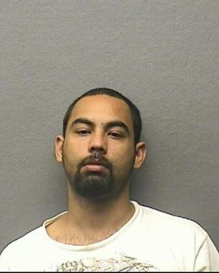 Fernando Morales, 28, has been charged after allegedly choking his girlfriend during an argument that escalated into an attack on June 15. Police believe he is a member of Houstone street gang. He has not been arrested. (Houston Police Department)