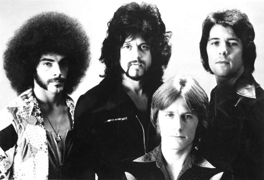 I GET THE JOY OF REDISCOVERING YOU: The 1976 incarnation of the band, before its first hit. Neal Schon radiated confidence from the beginning -- wearing a quilted blazer, a sideburn/mustache/soul patch trio and hair that blotted the sun. (Chronicle file)