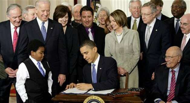President Barack Obama signs the Affordable Care Act in 2010. A divided Supreme Court upheld the act. Photo: Associated Press