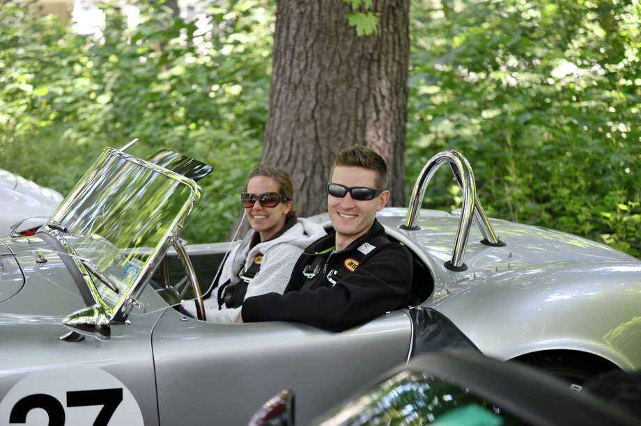 Larry and Victoria Kosilla of Darien sit in their replica 1966 Shelby Cobra at the seventh annual Darien Collectorís Car Show at Tilley Pond Park June 17, 2012. Photo by Henry Eschricht, Darien, Conn. Photo: Contributed Photo