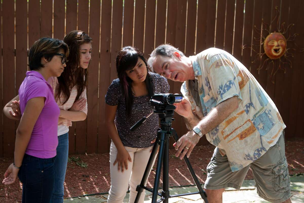Gresla Perdomo, 17, Cassy Puente, 17, Gabby Espinosa, 16, and Michael Cohn check composition during a session at 14 Pews, Cressandra Thibodeaux's indie film support shop.