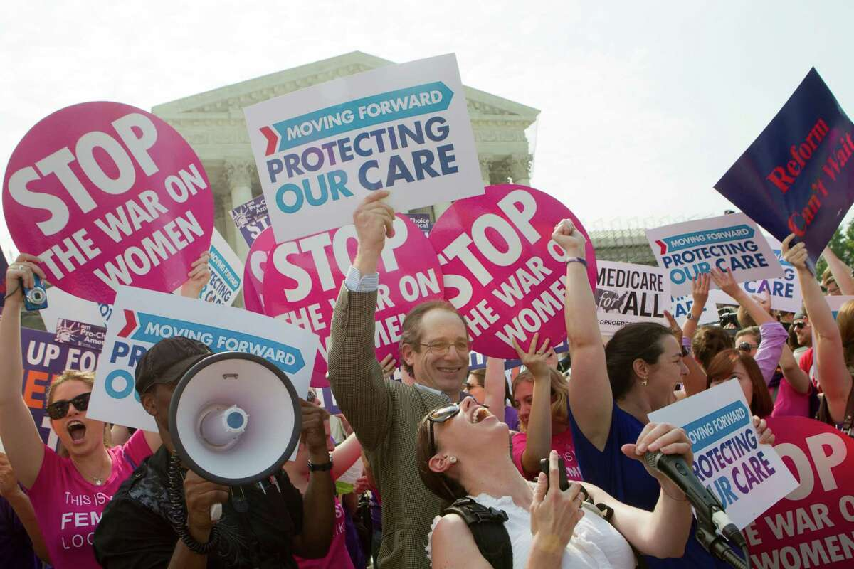 Supporters of the Affordable Care Act react to the ruling by the U.S. Supreme Court over the health care overhaul, outside the court in Washington, June 28, 2012. The Supreme Court on Thursday largely let stand President Barack Obama's health care overhaul, in a striking victory for the president and Democrats, with the conservative chief justice, John Roberts, affirming the central legislative pillar of Obama's term. (Stephen Crowley/The New York Times)