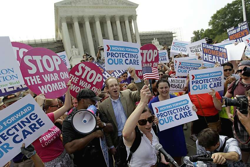 Supporters of President Obama's health care law celebrate outside the Supreme Court in Washington on Thursday.