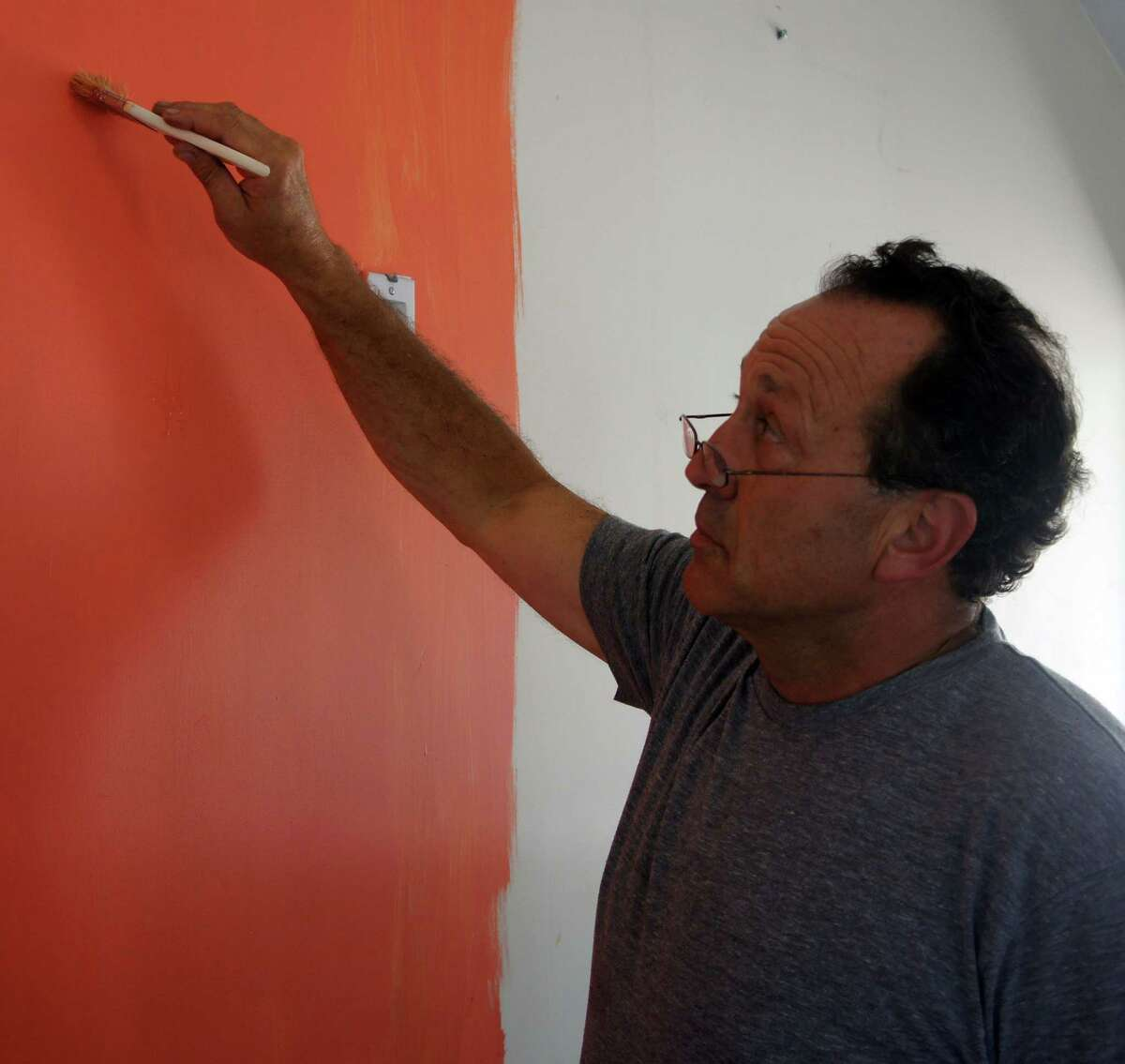 Adam Lubarsky, owner of the Blu Parrot, a new restaurant at 60 Charles St. in the Saugatuck section of town, does some painting inside the restaurant. The Blu Parrot is scheduled to open in late September or early October, Lubarsky said. Wednesday, June 27, 2012/ Westport, CT