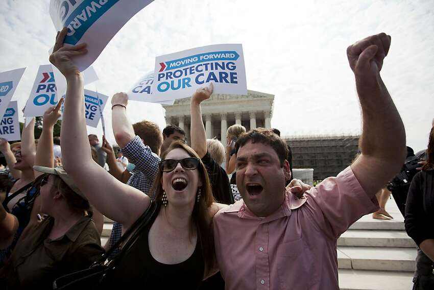 Claire McAndrew of Washington, left, and Donny Kirsch of Washington celebrate outside the Supreme Court in Washington, Thursday after a the court's ruling on health care.