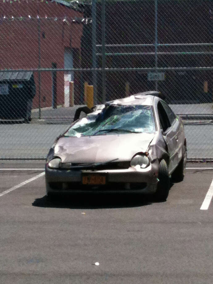 A car that authorities said was involved in a fatal crash on Thursday, June 28, 2012, in Stephentown sits in a parking lot at the Rensselaer County Sheriff's Office in Troy. (Matthew Hamilton / Times Union)