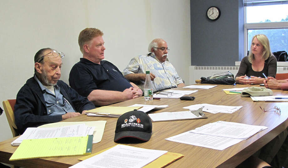 Town Government, Structure & Administration committee members Lloyd Plehaty, John Boulton, Vice Chairman Spencer Mcllmurray and Chairman Sarah Seelye revise the plastic bag ban ordinance at their meeting Monday, June 25, 2012. Darien, Conn. Photo: Thomas Michael