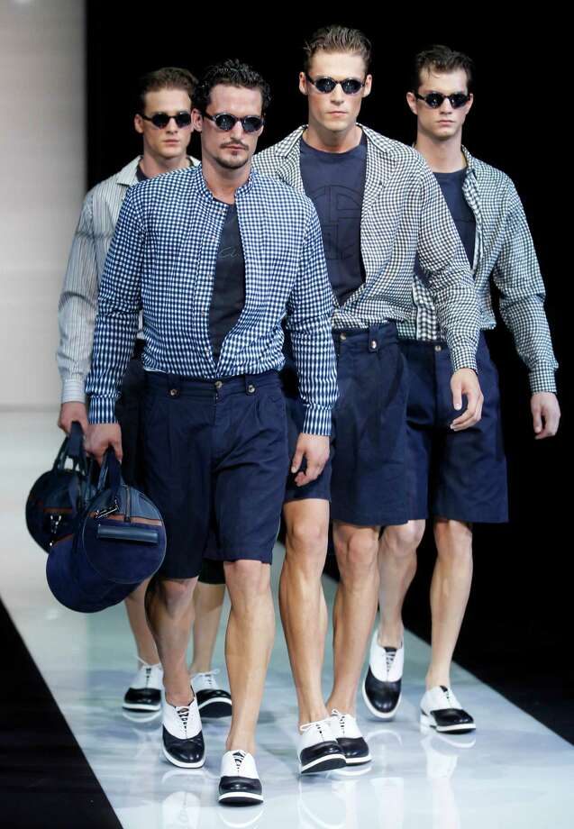Models wear creations of Giorgio Armani, from the men's Spring-Summer 2013 collection, part of the Milan Fashion Week, unveiled in Milan, Italy, Tuesday, June 26, 2012. Photo: Luca Bruno, AP / AP